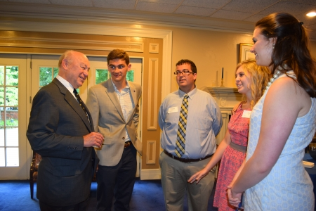 Paul Chellgren, left, talks with the 2014-15 class of Chellgren Fellows.