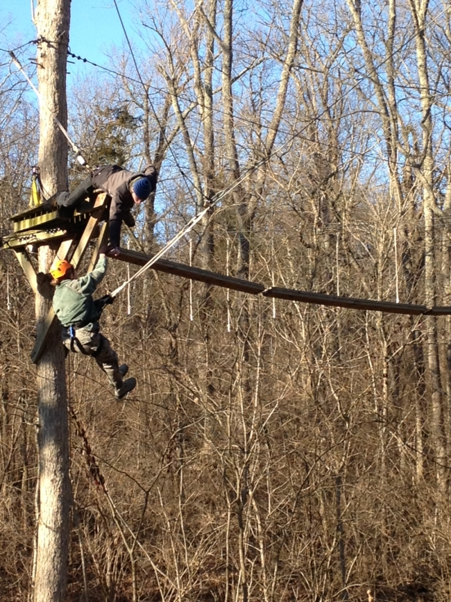 Cadet Garstang descends from through the Asbury Ropes Course via the 50ft tall swing.